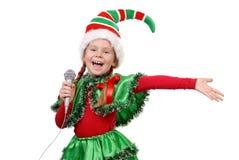 Dziewczyna - Santa elf z mikrofonem. Zdjęcia Stock