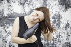 Dziewczyna suszarniczy włosy Fotografia Stock