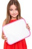 Dziewczyna trzyma białą deskę obraz royalty free