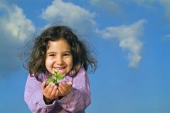 dziewczyna trzyma małą roślin Obraz Royalty Free