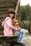 Dziewczyna trzyma psa Zdjęcie Royalty Free