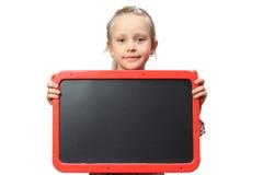 Mała dziewczynka trzyma pustego znaka Obrazy Stock