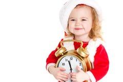 Dziewczyna ubierał jako Santa z dużym zegarem Obraz Royalty Free