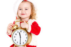 Dziewczyna ubierał jako Santa z dużym zegarem Zdjęcie Royalty Free