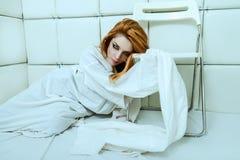 Dziewczyna ubierająca w straitjacket Obraz Royalty Free