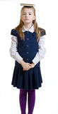 Dziewczyna utrzymuje książkę na głowie w mundurku szkolnym Obraz Royalty Free