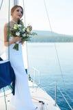 Dziewczyna w ślubnej todze fotografia stock