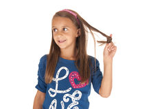 Dziewczyna w błękita odgórny bawić się z jej włosy Zdjęcia Stock