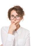 Dziewczyna w bluzki białych stojakach na białym tle, gesty, emocje na ona twarz Obraz Royalty Free