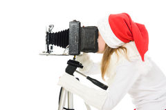 Dziewczyna w Bożenarodzeniowym kostiumu z starą kamerą Obraz Royalty Free
