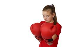 Dziewczyna w bokserskich rękawiczek ostrości na rękawiczkach Obrazy Royalty Free