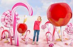 Dziewczyna w cukierek ziemi ilustracja wektor