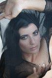 Dziewczyna w czarnej przesłonie Fotografia Royalty Free