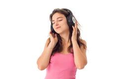 Dziewczyna w hełmofonach w studiu Fotografia Stock