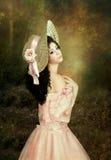 Dziewczyna w słomianym kapeluszu zdjęcia royalty free