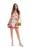 Dziewczyna w sleeveless kwiecistej sukni Obrazy Stock