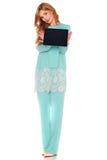 Dziewczyna w zielonym kostiumu z pastylka komputerem Fotografia Royalty Free