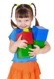 dziewczyna wręcza szczęśliwe małe zabawki Fotografia Stock