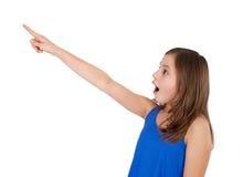 Dziewczyna wskazuje up Fotografia Royalty Free