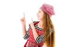 Dziewczyna wskazuje up w kuchennym upron Zdjęcie Royalty Free