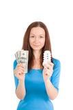 Dziewczyna z żarówką i pieniądze Fotografia Royalty Free