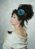 Dziewczyna z błękit różą Obraz Royalty Free