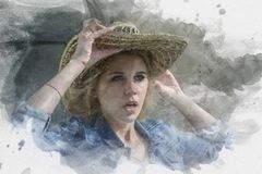 Dziewczyna z blondynem i niebieskimi oczami w dużym słomianym kapeluszu jest surpri Zdjęcie Stock