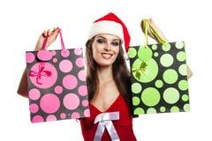 Dziewczyna z Bożenarodzeniowym zakupy w kapeluszu Święty Mikołaj Obrazy Royalty Free