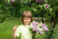 Dziewczyna z bukietem bzy Fotografia Stock
