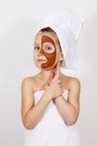 Dziewczyna z glinianą maską Zdjęcie Stock