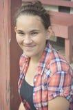 Dziewczyna z Koralową szkockiej kraty koszula Zdjęcie Royalty Free