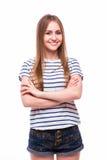 Dziewczyna z krzyżować rękami na bielu Obrazy Royalty Free