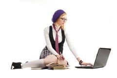 Dziewczyna z książkami i laptopem obraz royalty free