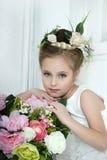 Dziewczyna z kwiatami Zdjęcia Stock