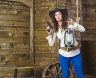 Dziewczyna z lampowym kowbojem Obrazy Stock