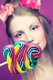 Dziewczyna z lizakiem Zdjęcia Stock