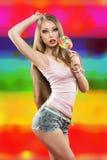 Dziewczyna z lizakiem. kolorowy tło Obraz Royalty Free