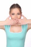 Dziewczyna z makeup zakrywa jej usta z bliska Biały tło Zdjęcia Stock