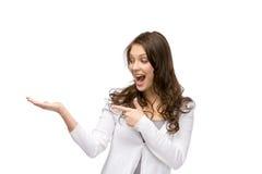 Dziewczyna z palmą up i wskazuje ręka gest Obrazy Stock