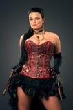 Dziewczyna z roczników pistoletami w steampunk stylu zdjęcia royalty free