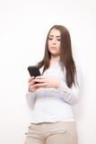 Dziewczyna z smartphone Zdjęcia Stock