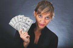 Dziewczyna z stertą dolarowi rachunki Obrazy Stock