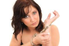 dziewczyna zakładająca kajdanki Obrazy Stock