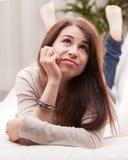 Dziewczyna zastanawia się coś który mógł zdarzać się Fotografia Royalty Free