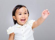 Dziewczynka ekscytuje z ręką up obrazy stock