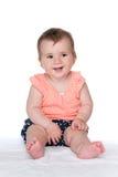 Dziewczynka siedzi na bielu Fotografia Stock