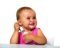 Dziewczyny łasowania jogurt Obraz Royalty Free