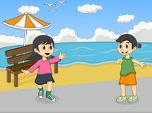 Dziewczyny bawić się przy plażową kreskówką Obrazy Royalty Free