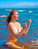 dziewczyny chełbotania woda Zdjęcie Stock