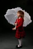 dziewczyny czerwony parasol gospodarstwa Zdjęcia Stock